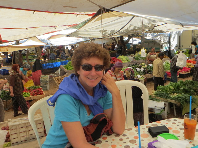 Laura savors gözleme in the Kaş market
