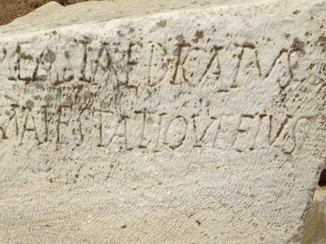 "The ancient Greeks wrote ""I LOVE ELVIS"" at the end of line two"