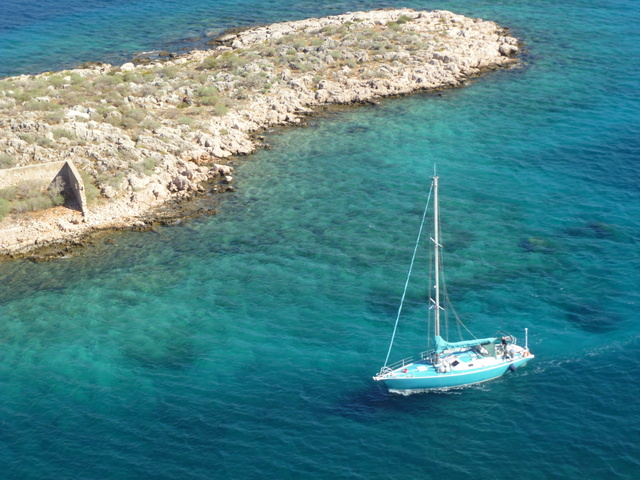 Sail boat makes it way from Mandraki Bay into the town basin at Kastellorizo