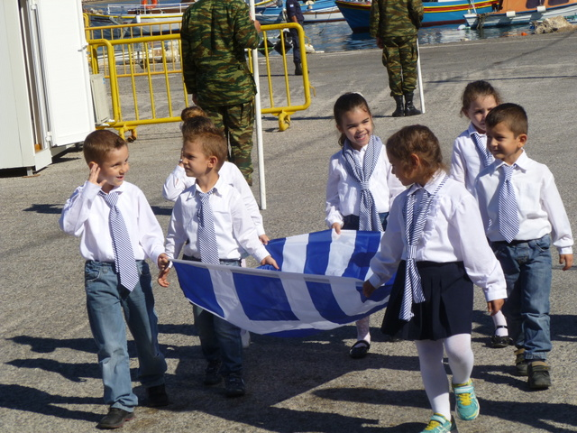School children carry the Greek flag for Ochi Day  (Kastellorizo)