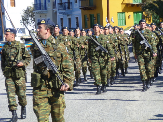 Soldiers from thee large military presence parade for Ochi Day (Kastelloizo)
