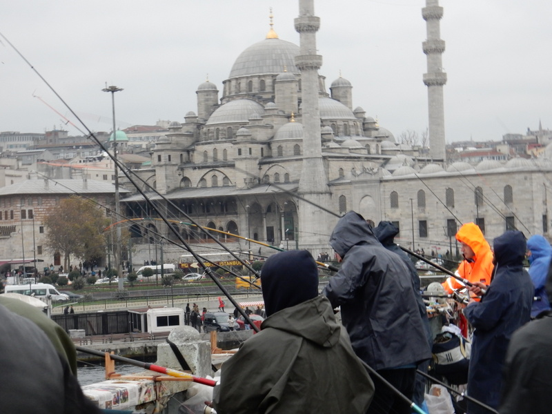 Fisherman on the Galata Bridge with the Sultan Ahmed Mosque (Blue Mosque) in the background
