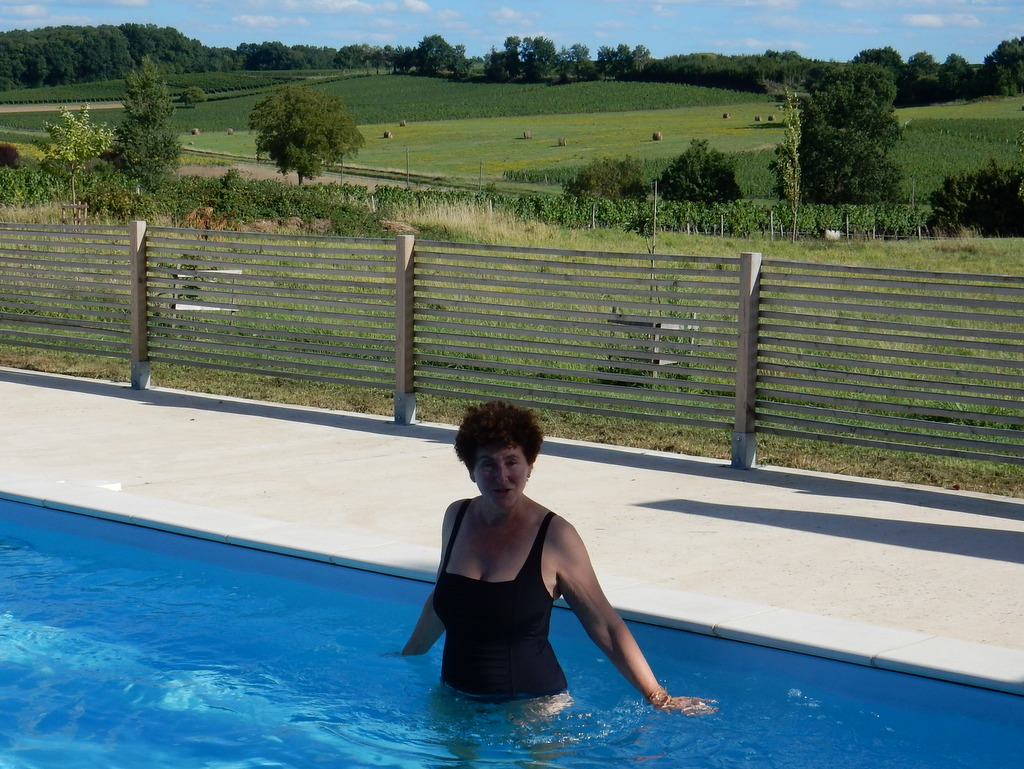 Laura tries out the pool (Grapes are almost ready for harvest in Vineyards surround our  chambre d'hôtes in Saint-Quentin-de-Caplong)