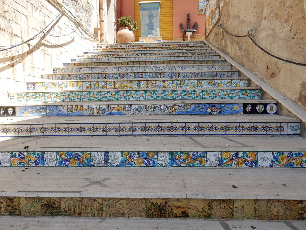 The city is full with painted ceramic tiles. There are at lest a dozen at the Lega Navale dock. These are on the stairs from the harbor to the town up on the hill.