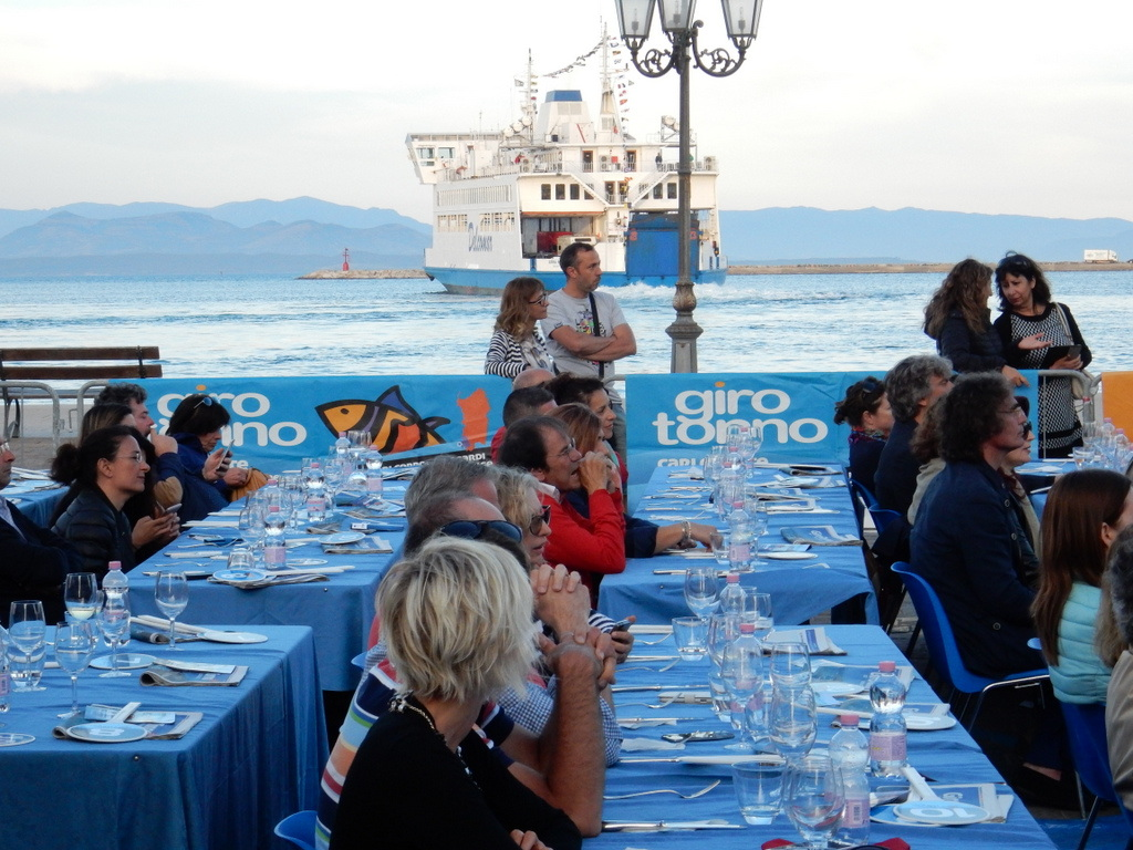 Judging tuna dishes prepared by an set of international chefs at the Giro Tonna, Carloforte