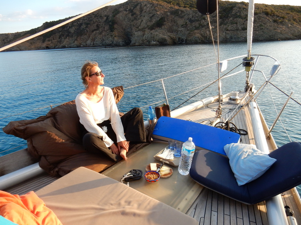 """Britta sits on the foredeck of """"Vera"""""""