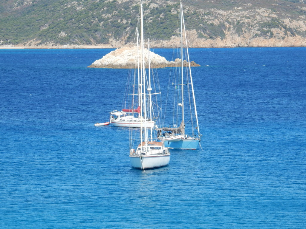 Sabbatical III, Vera, and Sassoon anchored together at Malfatano