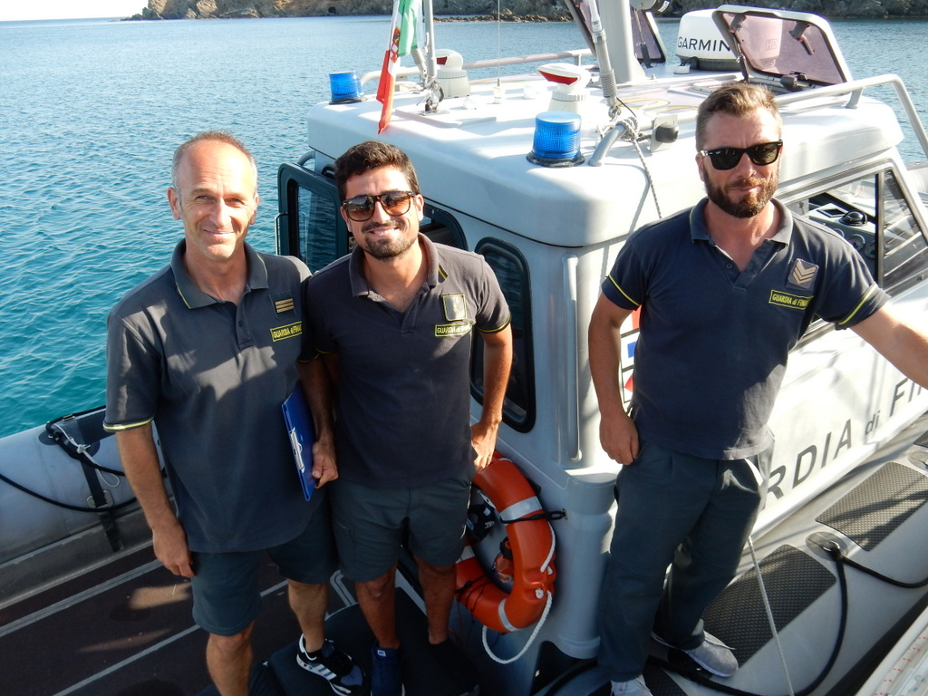 The Italian Financial Police pose after checking us out in Malfatano to be certain that we are not rich Italians on an untaxed sail boat. They were very friendly and professional.
