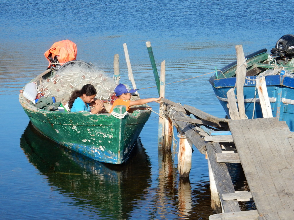 Children play in a fishing boat (Malfatano)