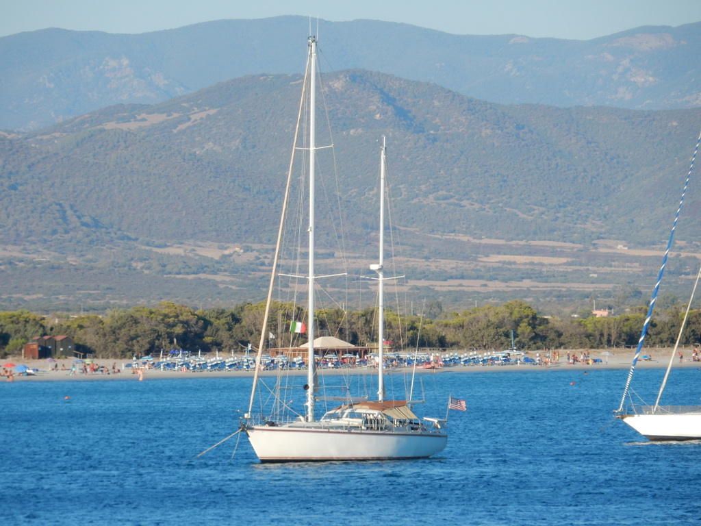 Sabbatical III lies at anchor in Porto Pino, Sardinia