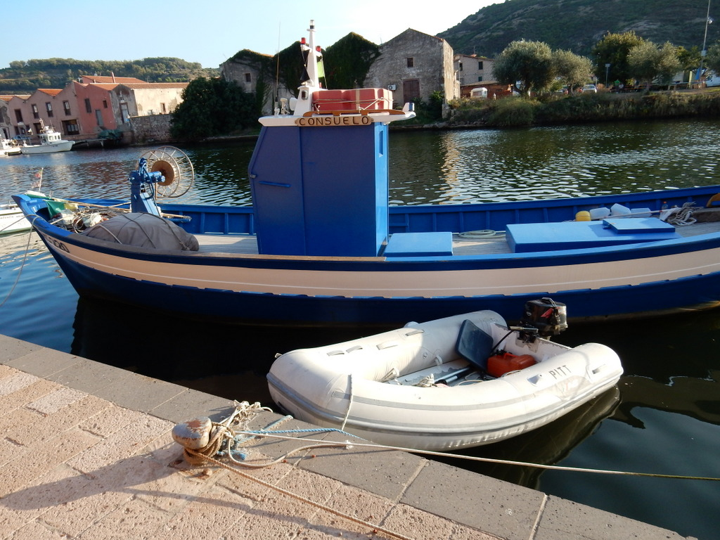 Our dinghy tied up to the quai in the river town of Bosa